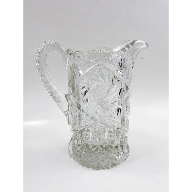 Circa 1910 American press glass pitcher, deep pin wheel pattern really sparkles. Heavy glass, size does not include...