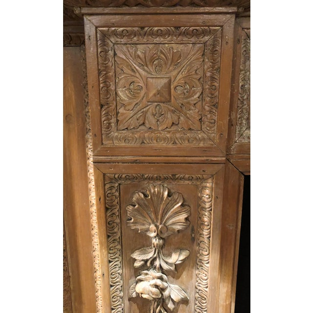 Antique English 19th Century Carved Wood Mantel with Carving in the Manner of Grinling Gibbons.