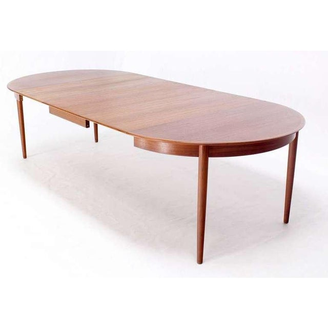 """Very nice Danish modern teak dining/banquet table w/ 3 leaves. Extends up to 108"""" long."""