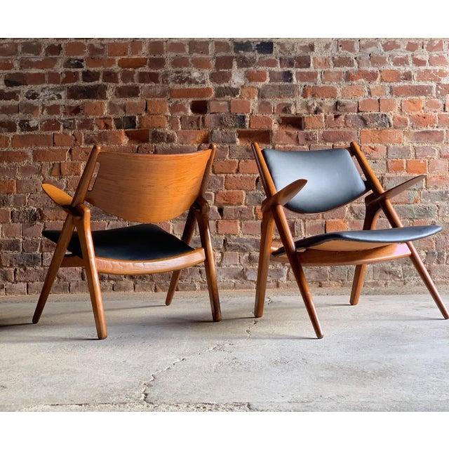 Magnificent pair of original CH28 oak Sawbuck lounge chairs by Hans J. Wegner for Carl Hansen and Son, Denmark, circa...