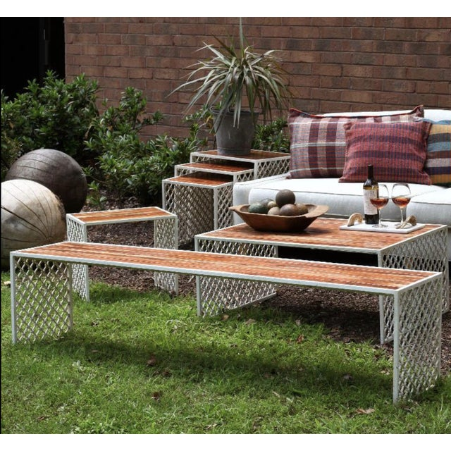 Inspired by traditional Jali screens in India with Acacia wood top. Powder coated for outdoor use with a glossy wood...
