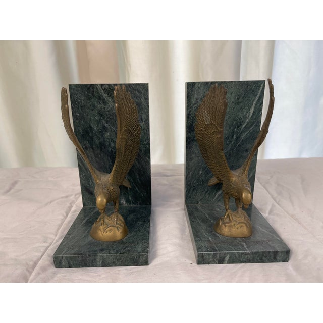 Pair of heavy brass eagle bookends on beautiful marble bases. In great condition with little wear.