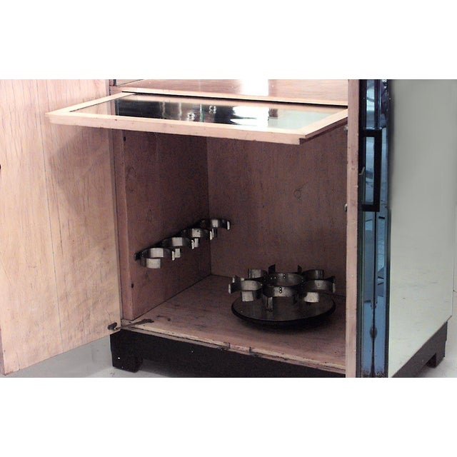 English Art Deco mirrored 2 door flip top bar cabinet with blue mirrored trim and black lacquered handles & base (fully...