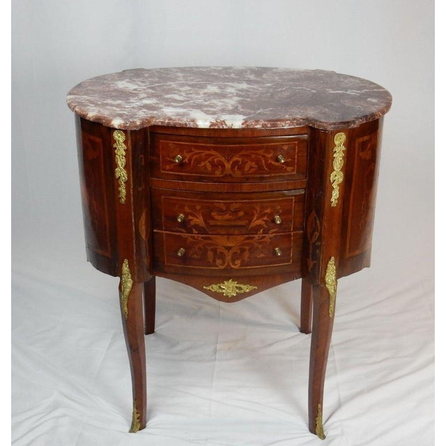 One of a kind Very Large Italian Marquetry Marble top stand. Inlaid with Satinwood, Rosewood, and a blend of Mahogany and...