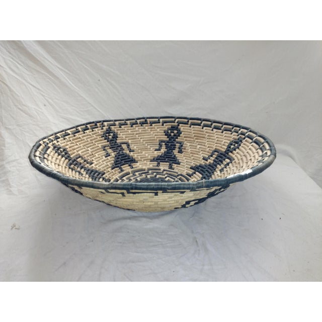 Gorgeous 1970's basket from Sri Lanka. Used for serving at banquets and weddings as well as for gathering. Figures all...