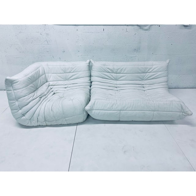 Two piece sectional Togo sofa in matte white leather. Designed by Michel Ducaroy for Ligne Roset, 1970s. Dimensions:...
