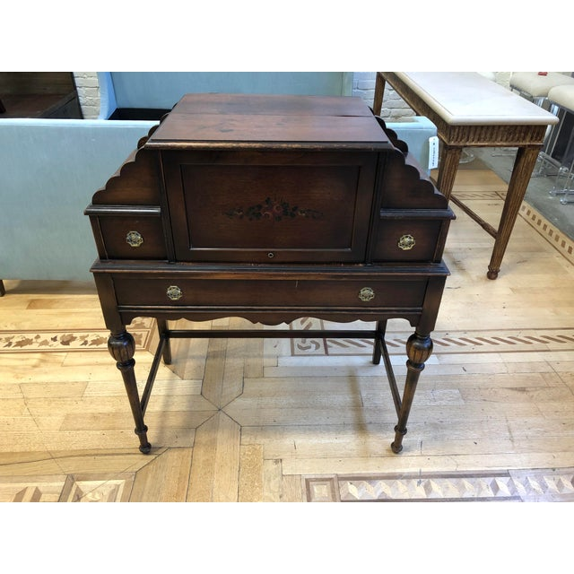 Design Plus Gallery presents an antique writing desk. Crafted of from woods, consist of drawers and multiple compartments...