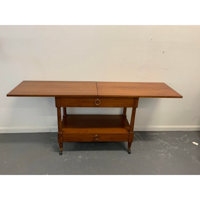 "Vintage Henredon, 2 drawer flip top extension serving table with wheels. Fully expanded 68"", closed 34"""