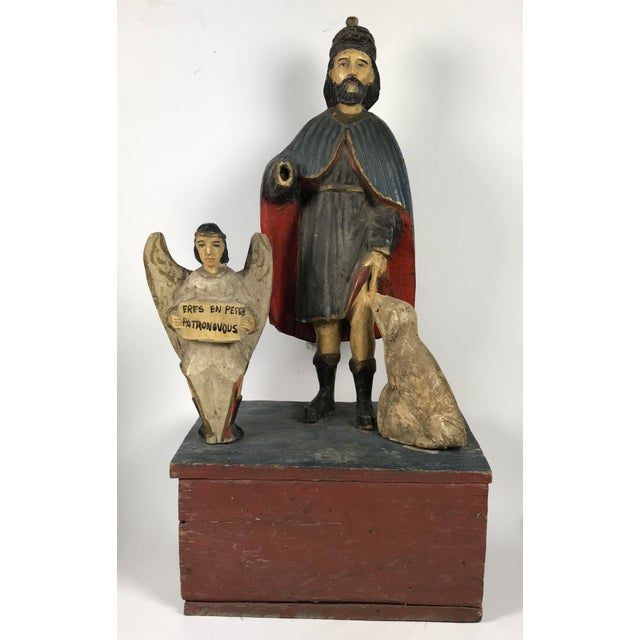 Here we have a beautiful and lovely religious Santos, 19th Century wooden carving of Saint Roch that is made by master...