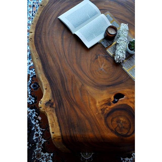 This is a gorgeous coffee table from Thailand made of acacia wood. Cut and carved from a single stump, this live-edge...