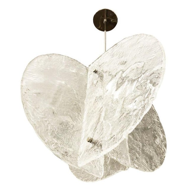 Stunning pendant composed of four textured, hand blown glass slabs connected by nickel joints. The way the glass slabs...