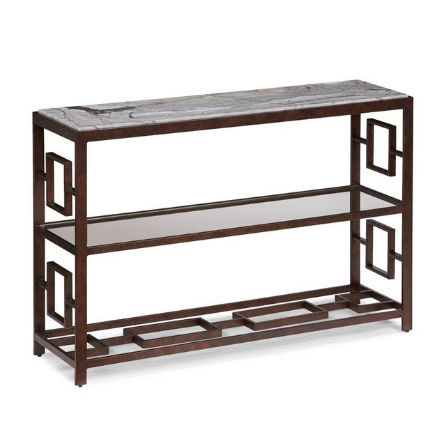 The Marcos Console Table This console table is an all-welded metal frame in a rich bronze hue. The top is very dramatic,...