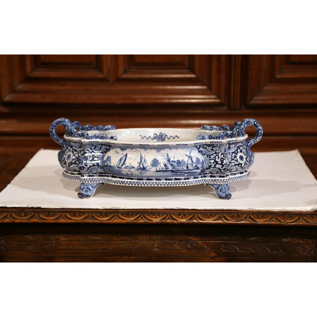 This large antique planter was crafted in France, circa 1920, oval and bowed all around, the blue and white faience...