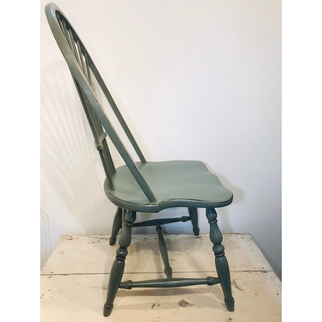 A wonderful Windor chair painted in a cool celedon green with touches of dark glazing and intentional distressing....