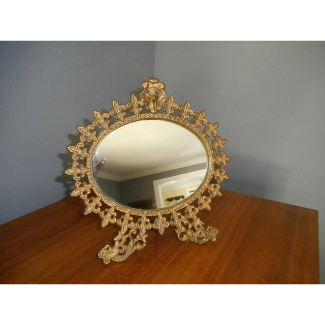 Early vintage standing mirror for vanity. Gilt in good condition. oval shaped mirror. Purchased from an estate sale.