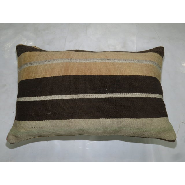 Large Pillow made from a vintage turkish rug with cotton back. Zipper closure and foam insert provided. 15'' x 23'