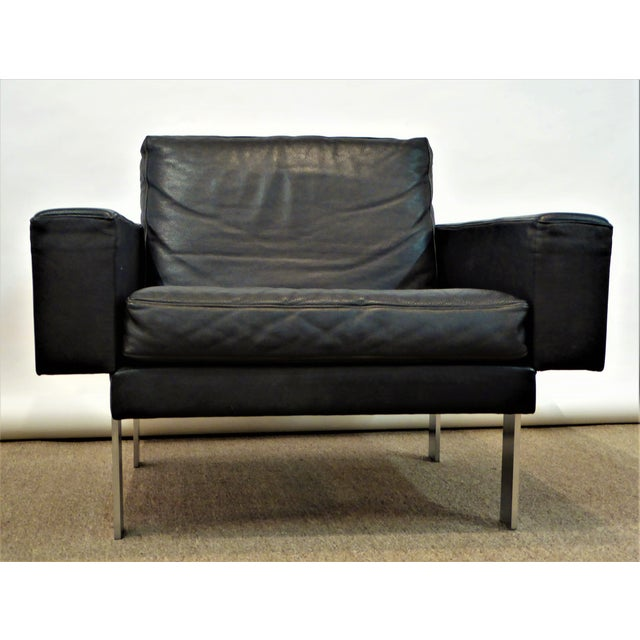 This fine mid-century modern Danish leather armchair with its stainless steel legs, was designed by Illum Wikkelso and...