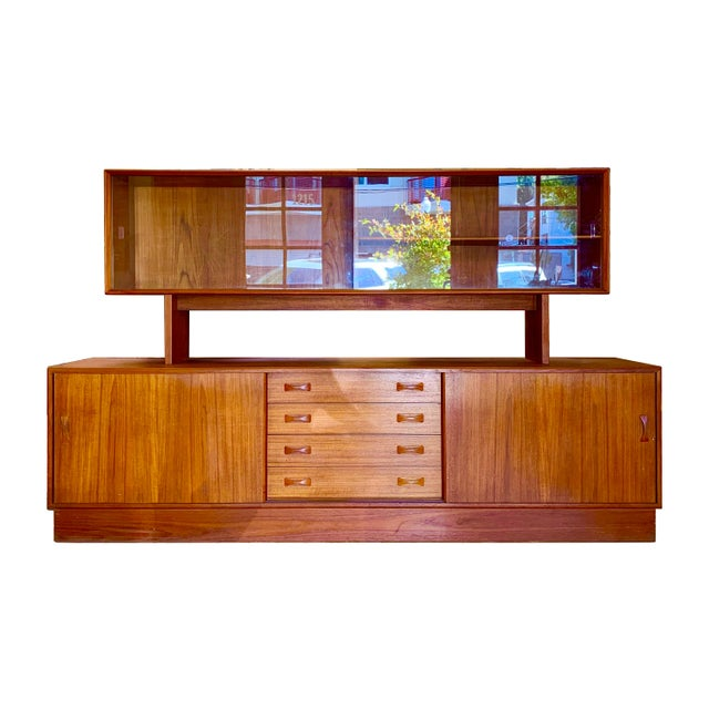 1960s Danish Modern two-piece teak china hutch by Clausen & Søn. The two pieces are detachable. The top has sliding glass...