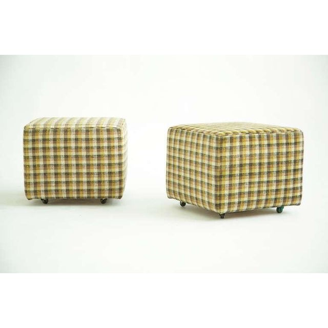 Pair of ottomans from Frey House in Palm Springs. Dorothy Liebes fabric. Signed in pencil on fabric label to underside of...