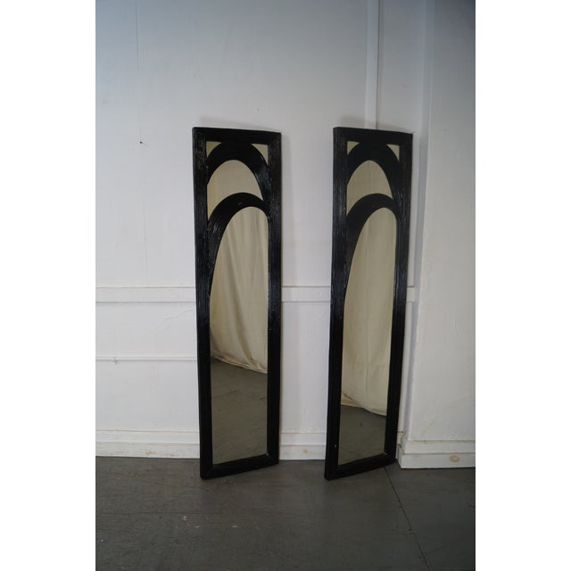 Mid-Century pair of black painted tall narrow reeded design mirrors. AGE/COUNTRY OF ORIGIN: Approx. 30 years, America....