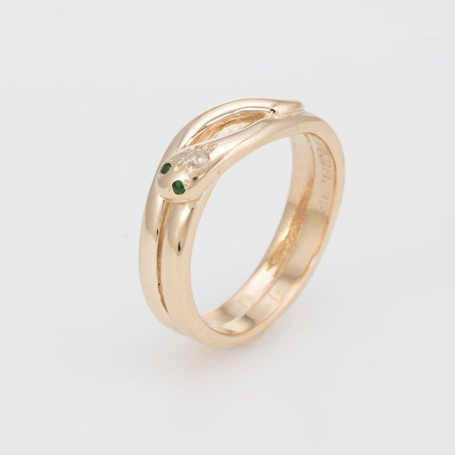 Finely detailed vintage snake ring, crafted in 18 karat yellow gold. One estimated 0.05 carat old mine cut diamond...