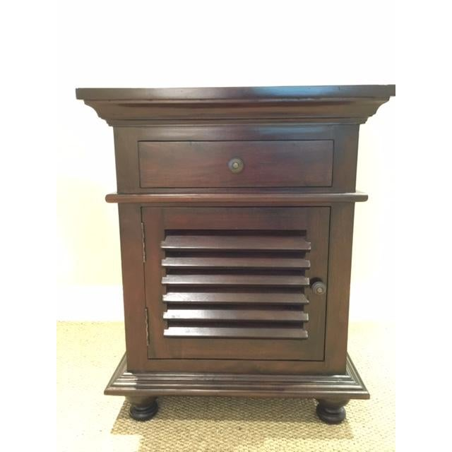 Shutter side table by NOIR Furniture Los Angeles. It has 1 drawer and storage space below it. It's done in the original...