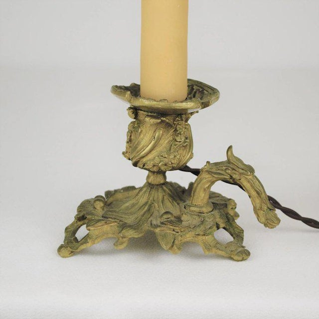 A striking 19th century bronze candle holder fashioned into an electrified candlestick. The casting detail is nicely done....