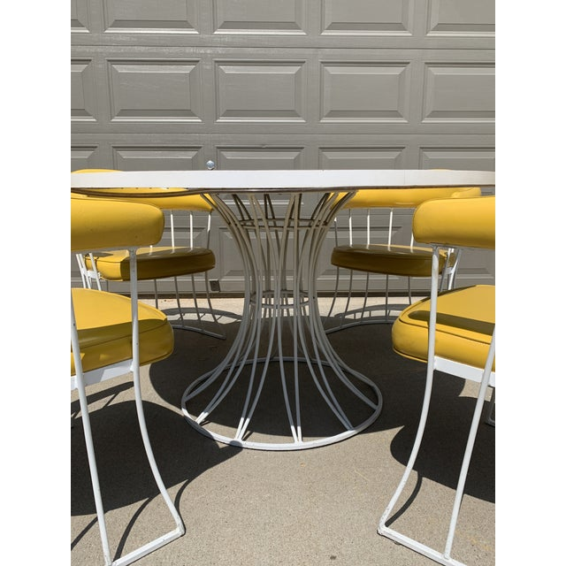 Wishing to have the coolest dinette set on the block? Here it is! This is a beautiful tulip base dinette set by Blacksmith...
