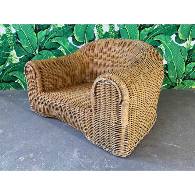 Sculptural wicker chair in the manner of Michael Taylor or Eero Aarnio. Good vintage condition with minor imperfections...