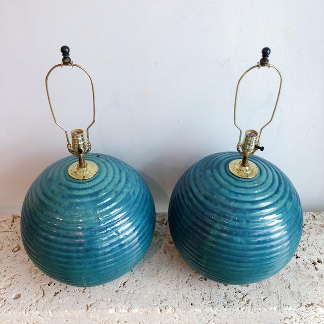 Big pair of blue, green, teal glazed terra cotta ball lamps from a Designers estate in Palm Beach. Original brass fittings...