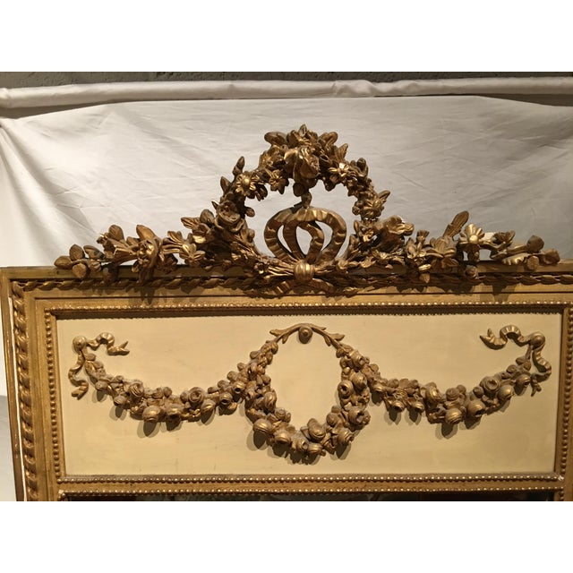 """This is a """"wow"""" mirror! Gold sculptural details outside the mirror and in the top panel really set it apart. In good..."""