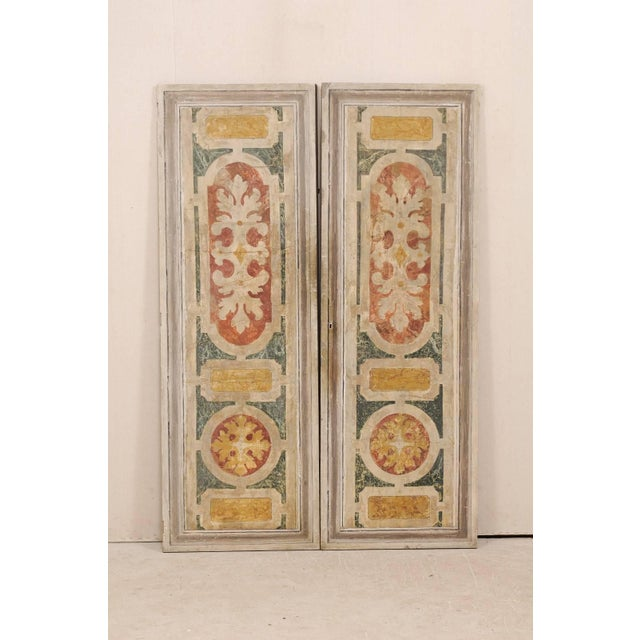 A pair of Italian wooden doors, decoratively painted, from the mid-20th century. This pair of vintage Italian doors...