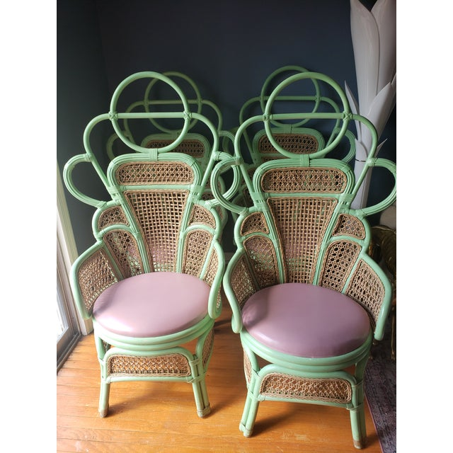 Rare bent bamboo or rattan chairs with synthetic cane backs and details. Visually stunning, everything from the sculptural...