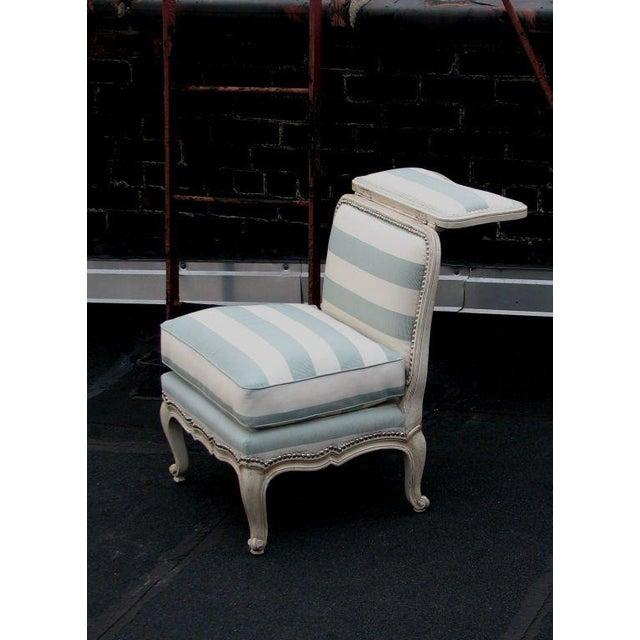 An unusual Louis XV style Voyeuse side chair with a folding hinged back and loose seat cushion. Custom versions available....