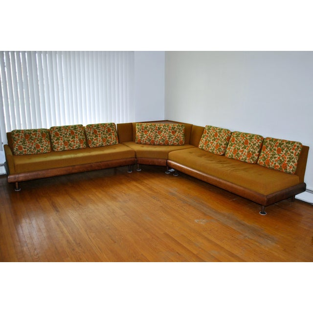 Vintage orange-and-green three-piece sectional sofa with paisley cushions, walnut wood frame and built-in walnut Plycore...