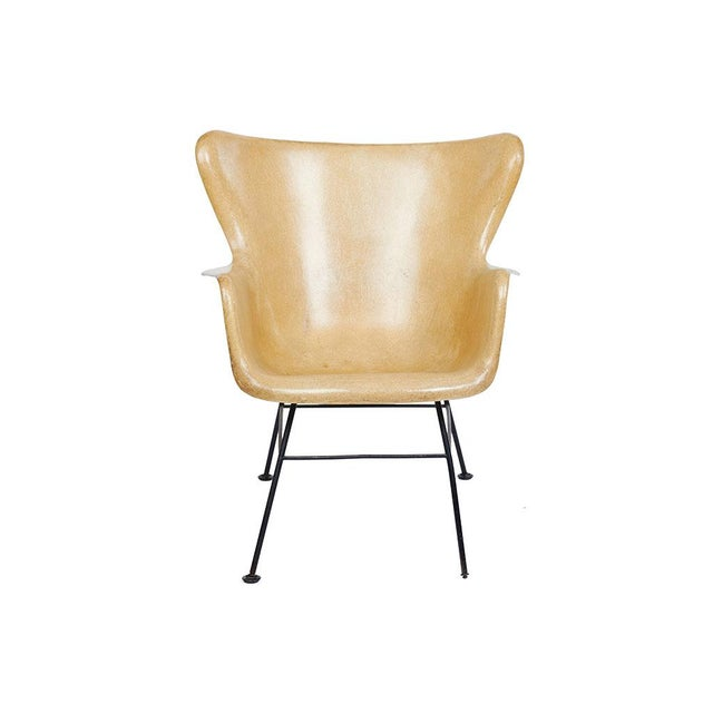 Pair of handsome mid-century modern Lawrence Peabody wingback chairs with a mustard seed yellow fiberglass shell. Circa...
