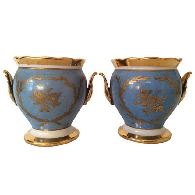 """Pair of French cachepots. Signed """"Made in France."""""""