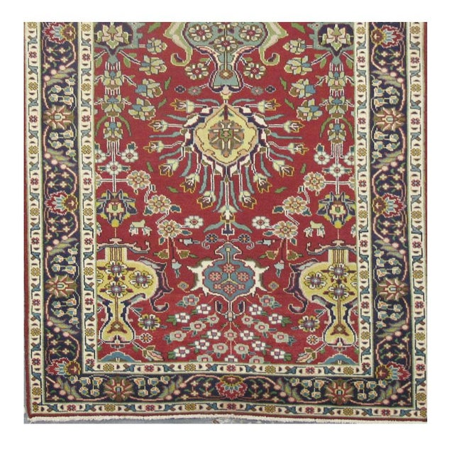 This beautiful rug is hand made, made in Iran. It features a pattern in a vibrant combination of red, navy, blue, yellow,...