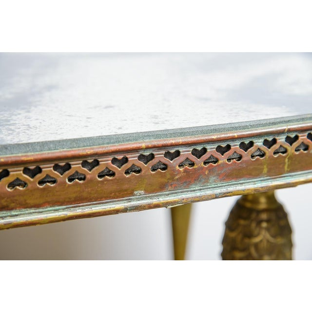 French C.1940-50 oval Brass gallery cocktail table with a beautiful antique mirrored top. Stunning set of Bronze legs with...