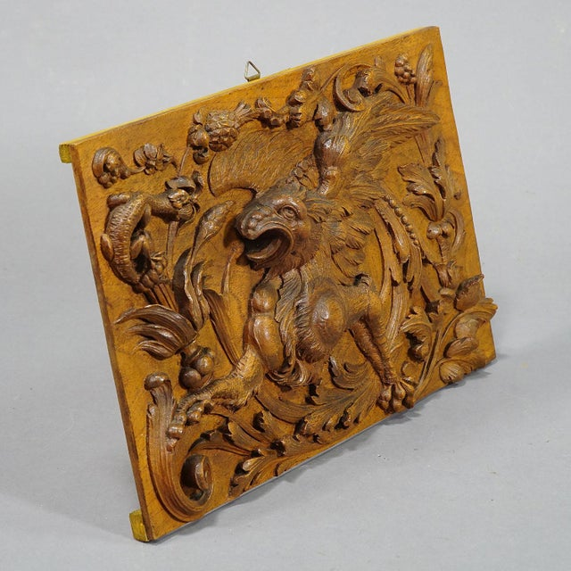 a handcarved wooden panel with gargoyle, lizard and phantastic foliage and plants. handcarved in germany ca. 1920. width:...