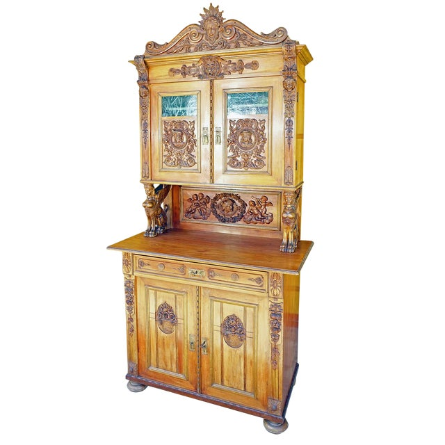 Antique Wooden Carved Cupboard With Several Carvings For Sale