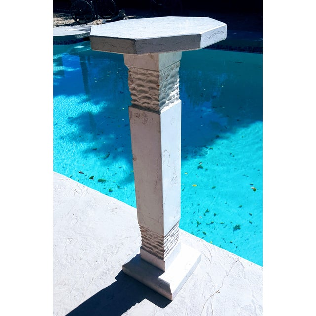 """A heavy solid pedestal of assembly of sculpted and hewn Italian Botticino marble. The base of this 31"""" tall pedestal is 8""""..."""