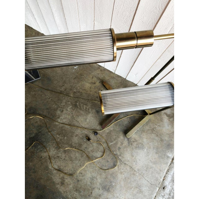 Wonderful pair of post-modern Casella Pharmacy floor lamps in brass. Featuring glass rod shades, in a half cylinder shape,...
