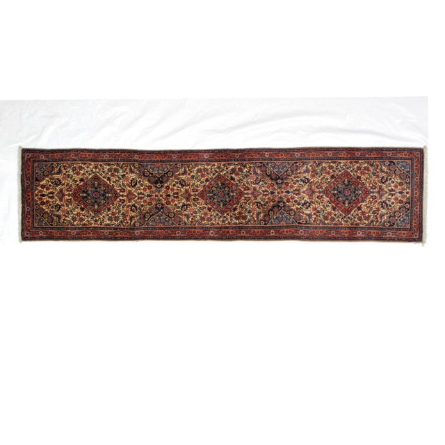 Offering a wool pile hand made vintage Persian Sarouk runner that is in excellent condition.