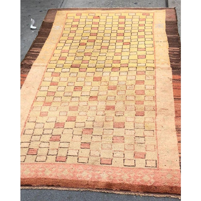 Combining ancient weaving traditions with rustic Minimalist influences, this vintage Turkish Tulu rug represents the...