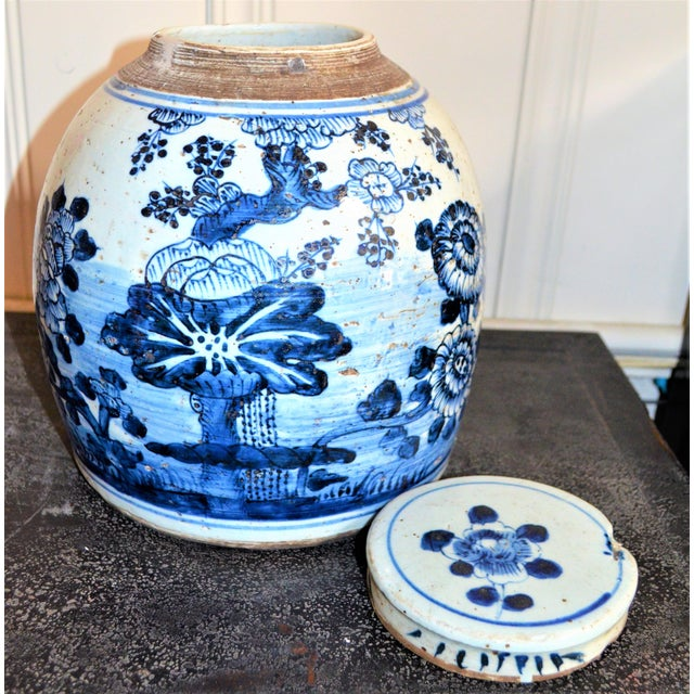 This is a beautiful large blue & white Chinese porcelain ginger jars. This large rounded jar has a unique large floral...