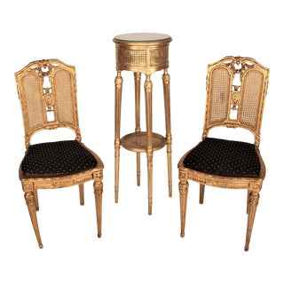 French Louis XVI Style Carved Fauteuils Cane Seating Set - 3 Pieces For Sale