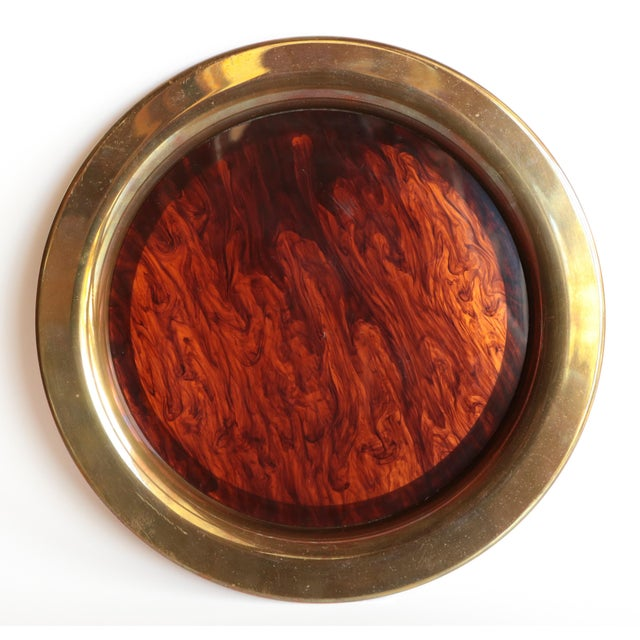 Vintage faux tortoiseshell tray from Oneida. The semi-translucent hard plastic center is surrounded by a brass tone rim....