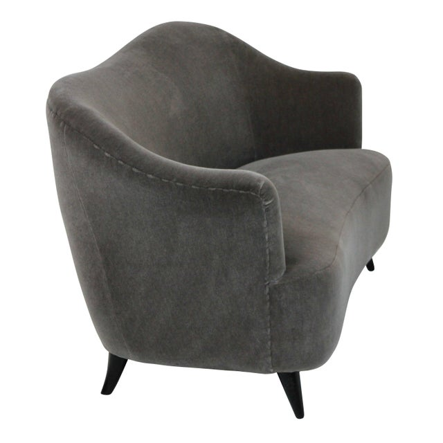 A sculptural Italian two set sofa with ebonised legs and newly upholstered in Donghia of NY mohair velvet.