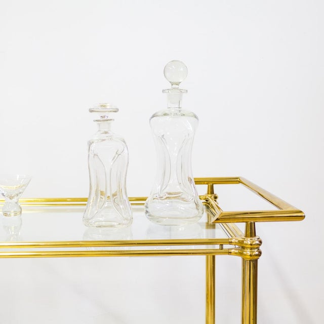 Holmegaard Kluk Kluk Decanter by Danish designer Jacob E Bang is named for the sound it makes in pouring and designed...